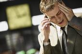 Man_on_phone_headache_1